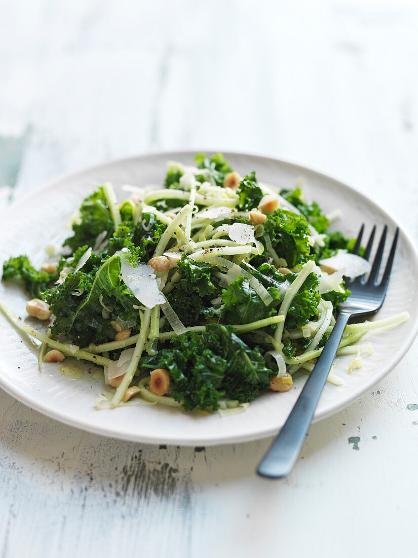 Broccoli leaf salad with onion, celery root, parmesan and hazelnuts
