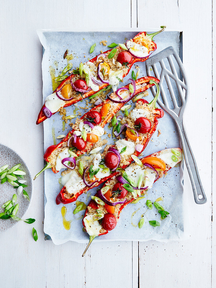 Sweet peppers stuffed with bulgur, cherry tomatoes, red onions, cream and spring onion