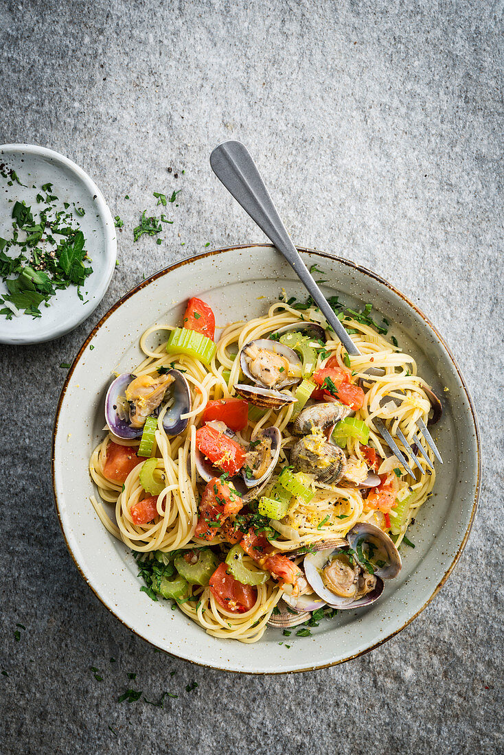 Spaghetti with clams, tomatoes and celery with white wine sauce