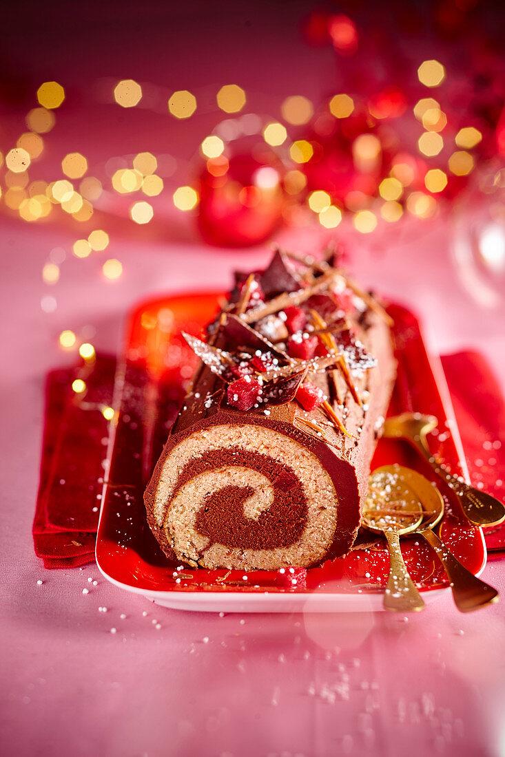 Chocolate and cranberry Christmas log cake