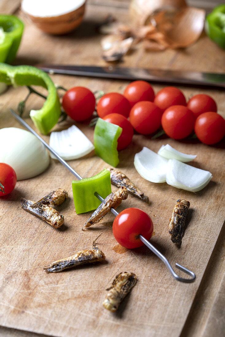 Preparing grasshopper skewers