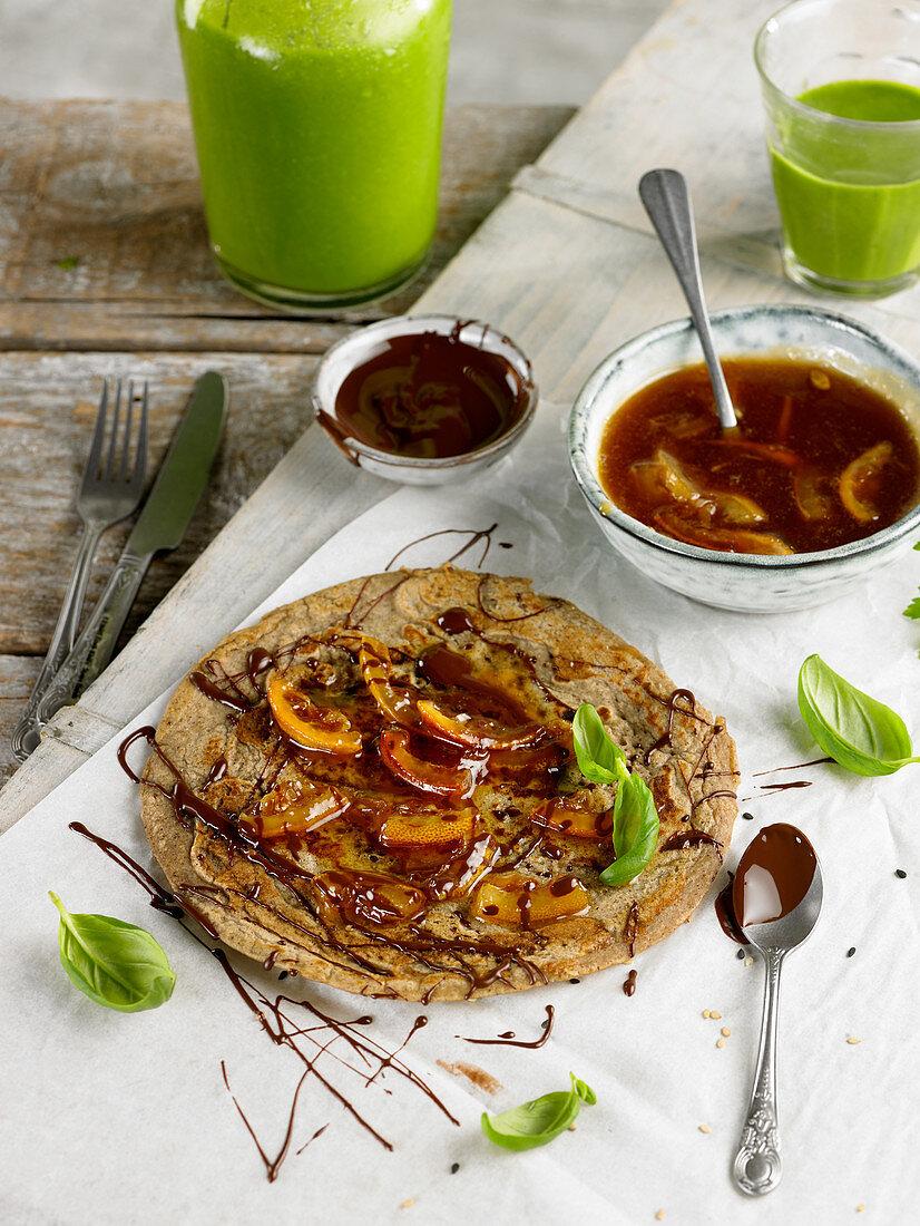 Pancake with lemon syrup and chocolate sauce