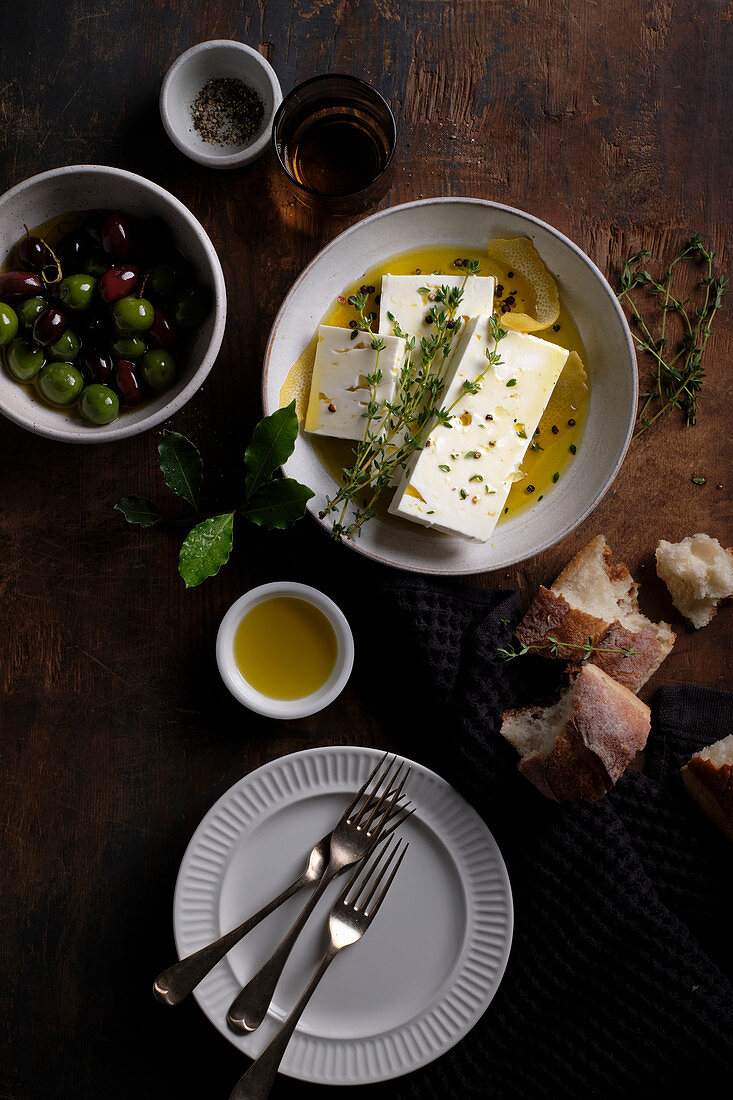 Feta cheese marinated with bay leaves, thyme, lemon zest and black pepper, served with green olives and kalamata olives