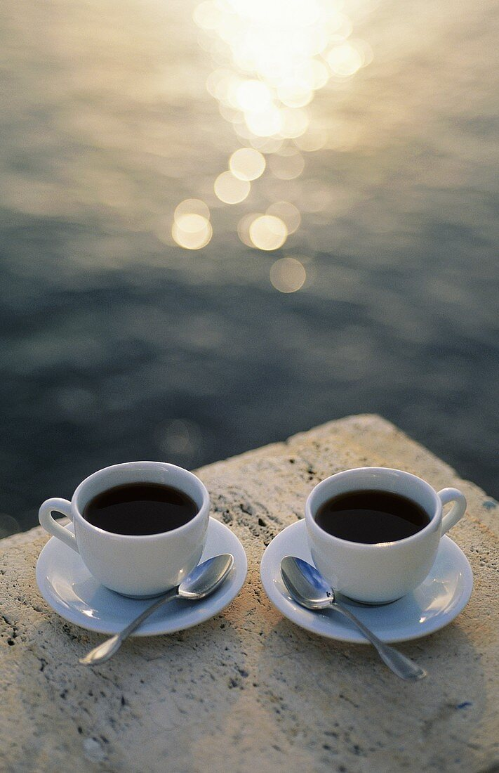 Two Cups of Coffee by the Ocean at Sunset