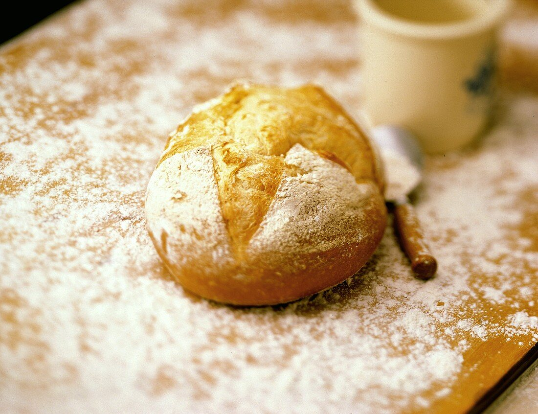 Loaf of White Mountain Bread on Floured Surface