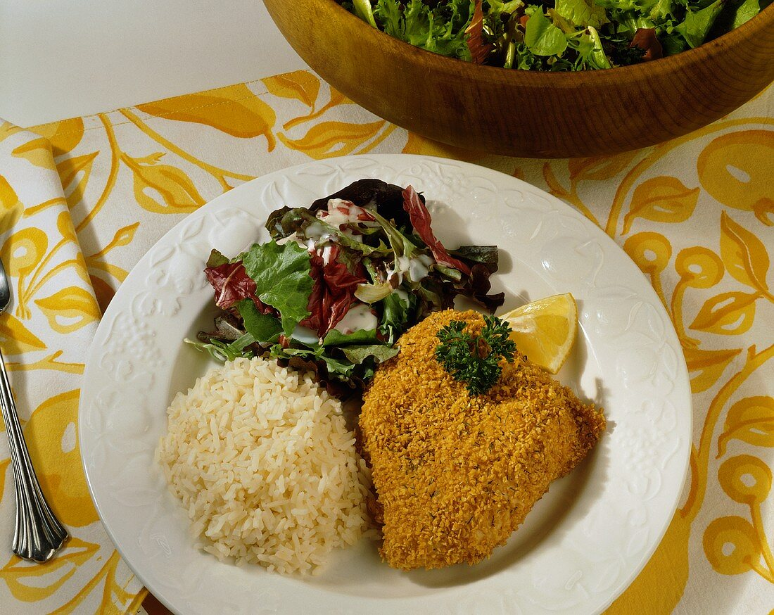 Breaded Fish Fillet; Rice and Salad