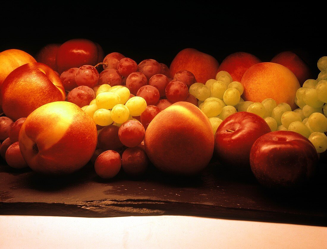 Mixed Fruit Still Life; Grapes Nectarines and Apples
