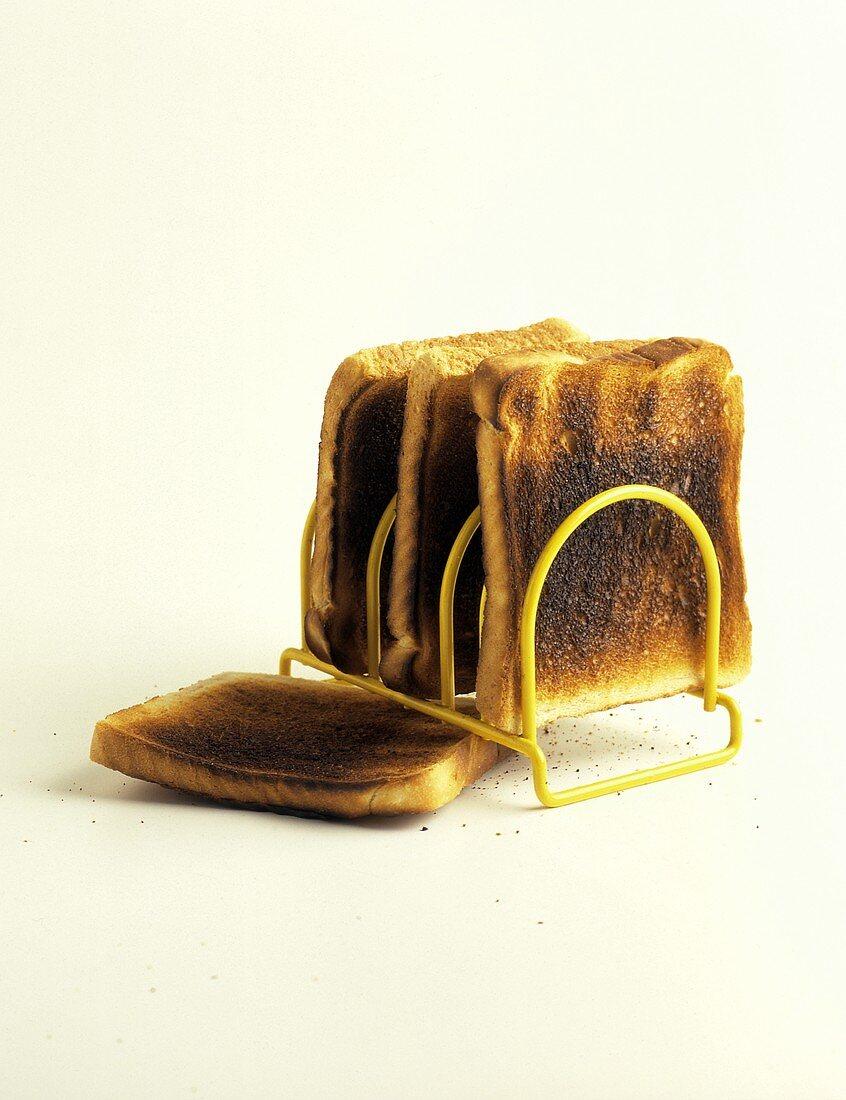 Burned Toast in Toast Rack