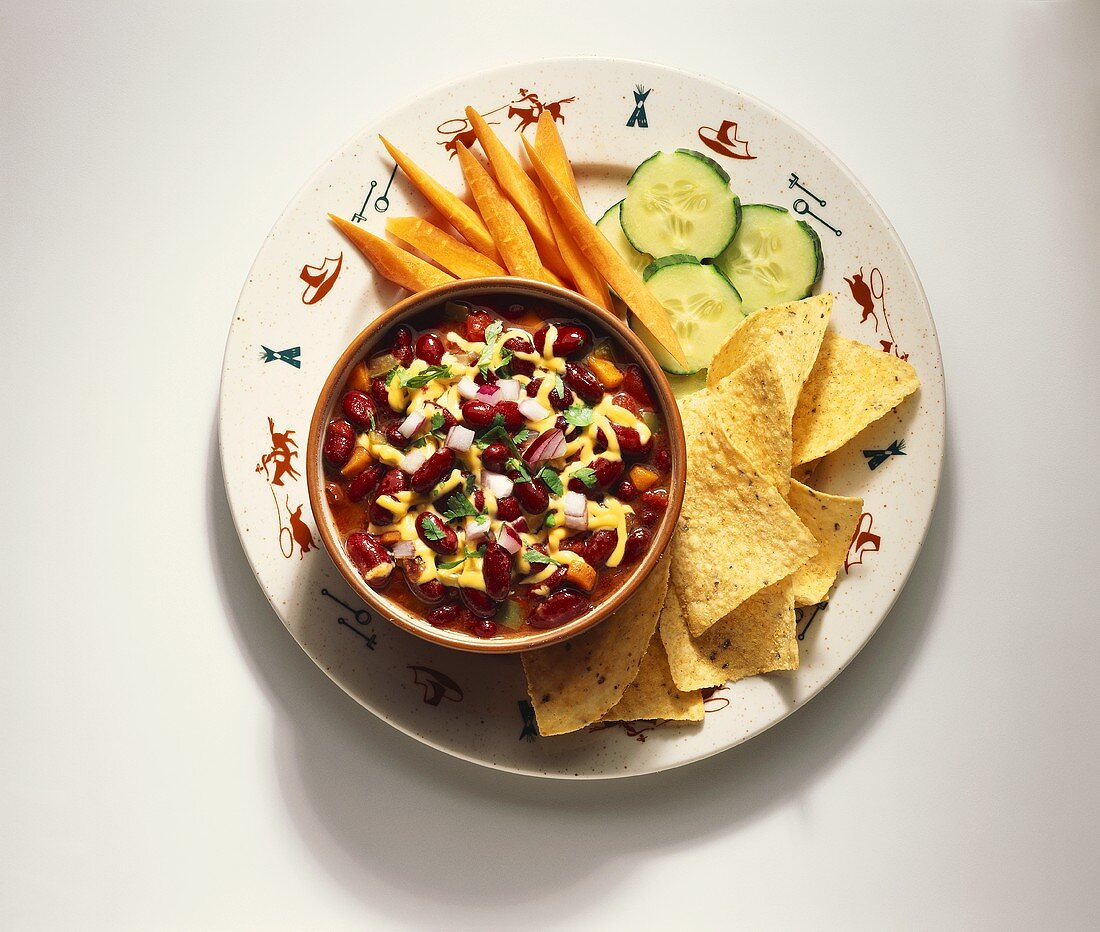 A Bowl of Chili with Tortilla Chips and Veggies