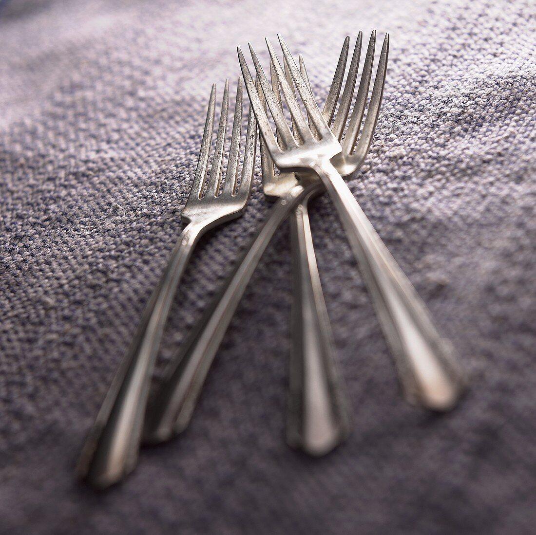 Forks on a Purple Background