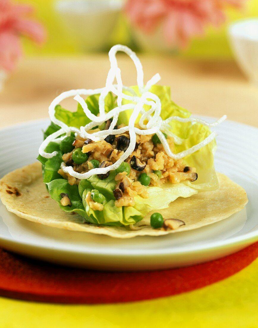 Cereal salad with peas on lettuce leaf