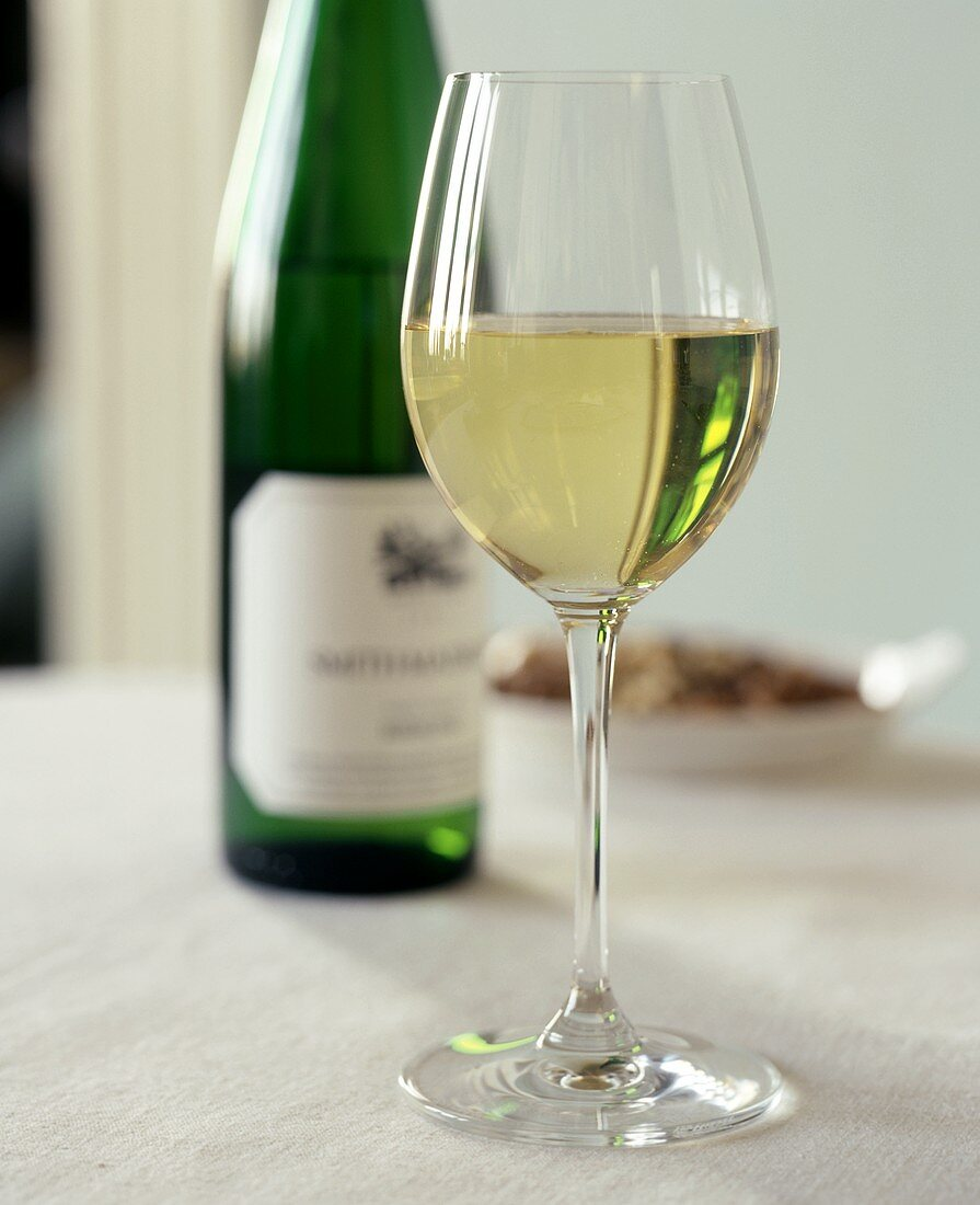 A Glass and Bottle of Riesling; Nuts