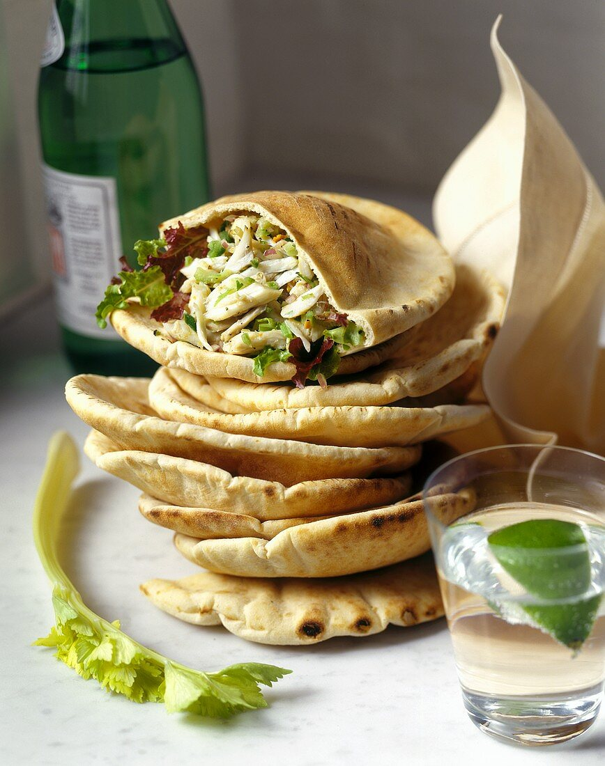 Pita bread filled with crab salad; mineral water