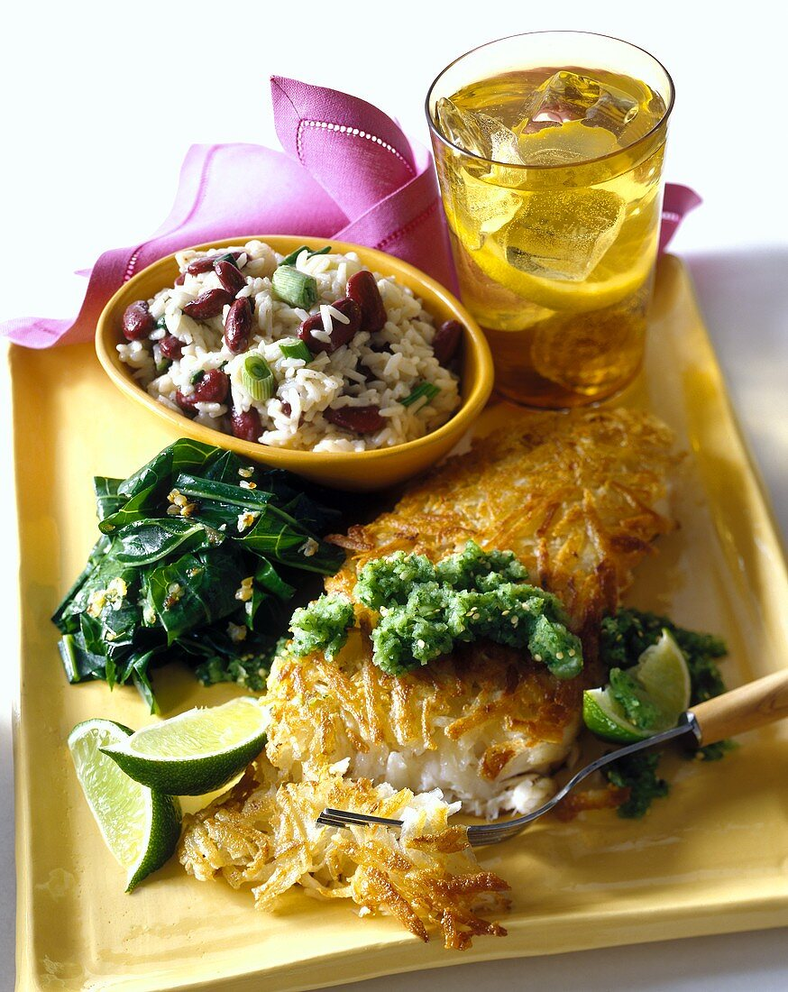 Crispy sea bass fillets with salsa verde and beans and rice