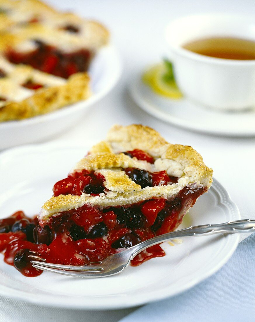 A piece of strawberry and blueberry tart