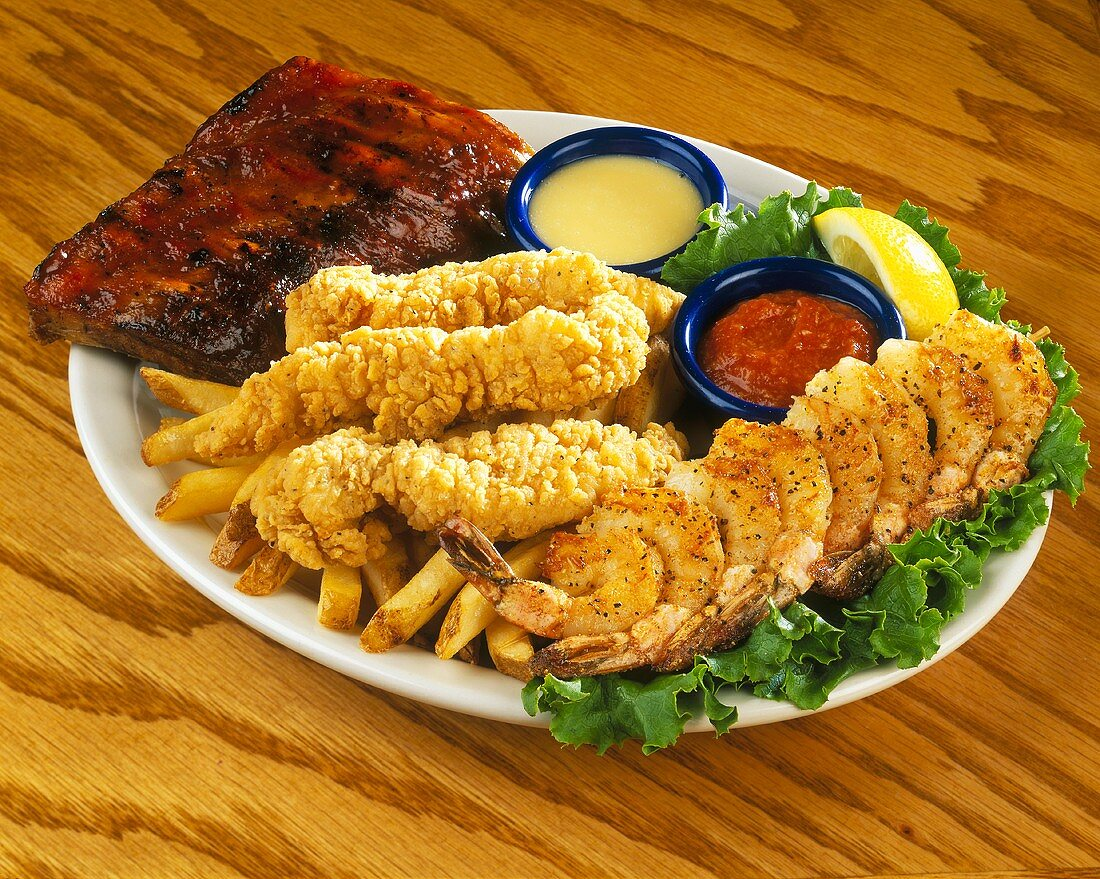 Chicken Tenders, Shrimp and Ribs with Fries and Sauces