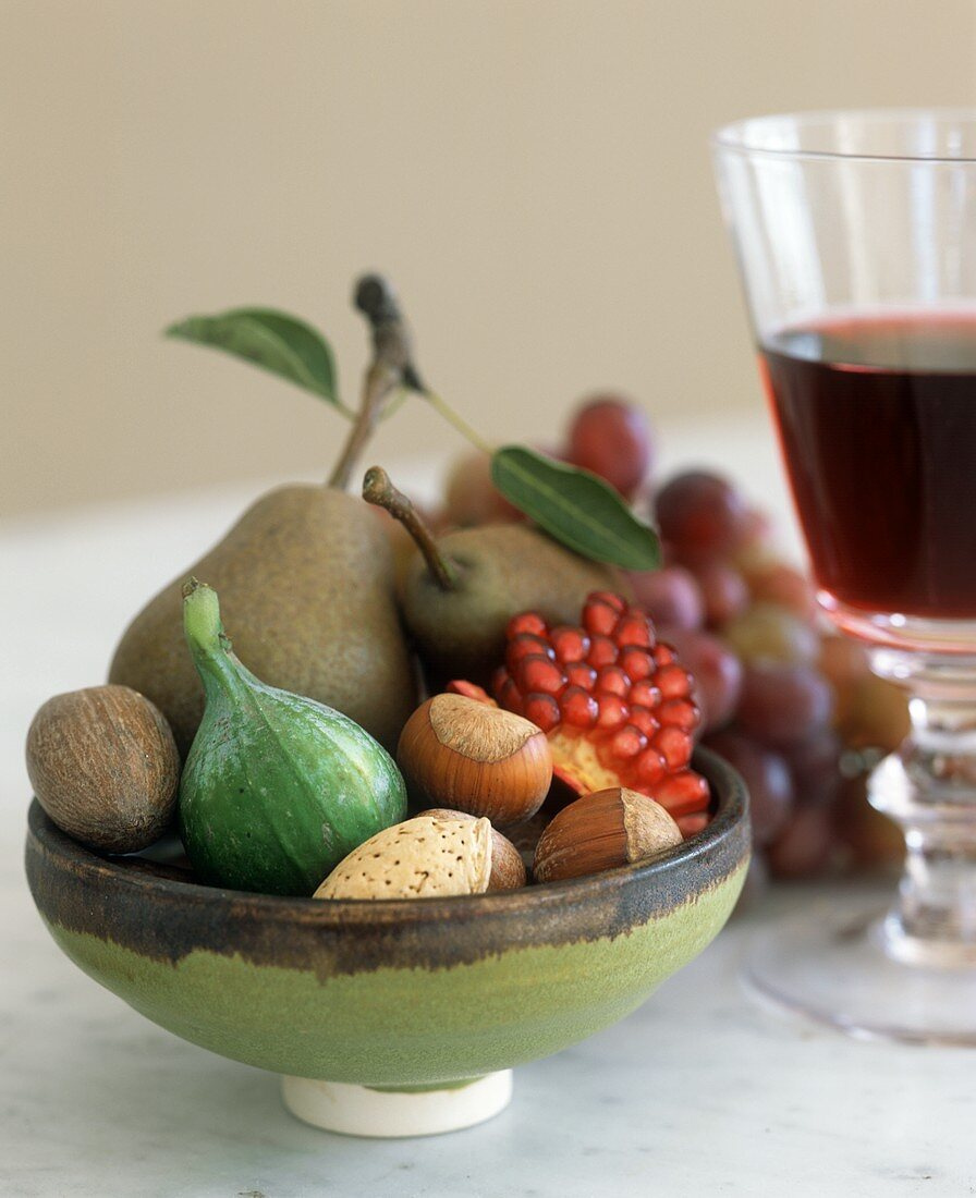 A bowl of fruit and nuts