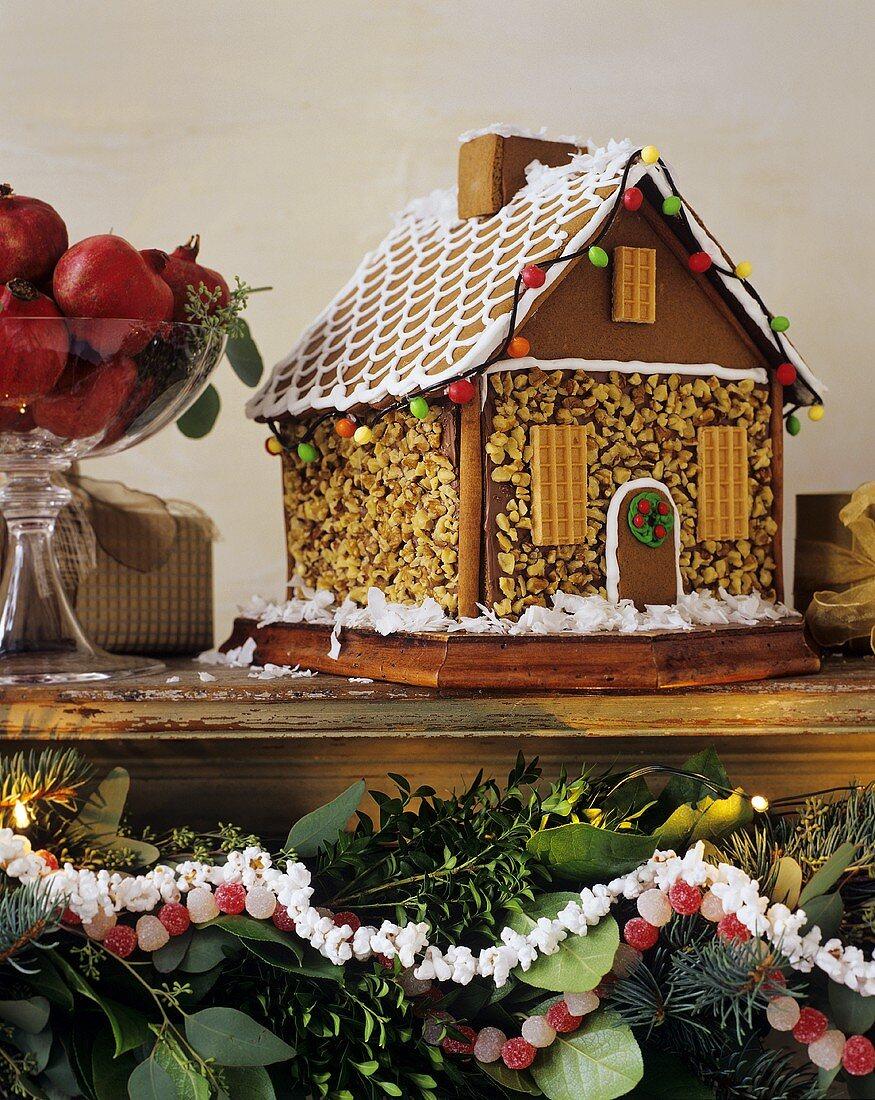 Gingerbread house on a wooden shelf