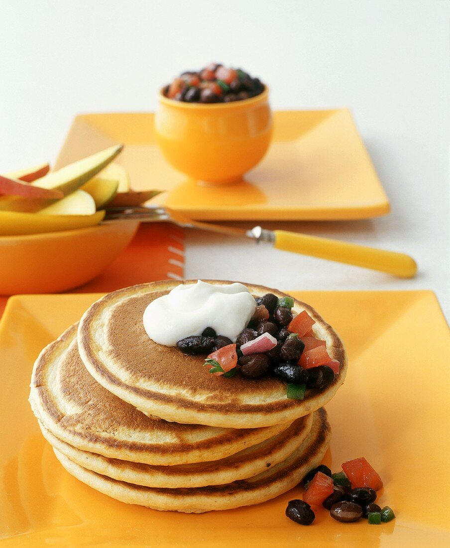 Pancakes with bean salsa and sour cream