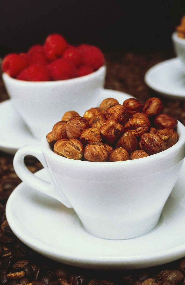 Dessert Cups; Shelled Filbert Nuts in a Cup and Raspberries in a Cup