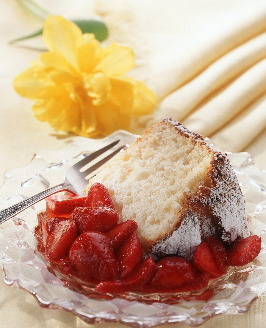 A Slice of Angel Cake with Strawberries and a Fork