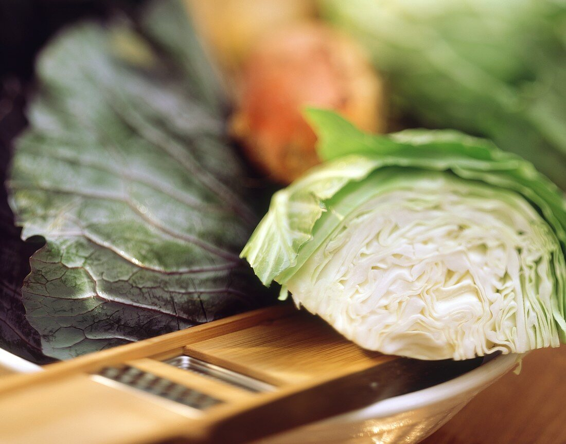 A Piece of Cabbage Head on a Wooden Grater