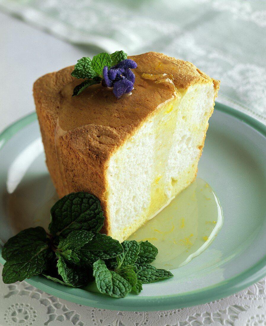 A Slice of Angel Food Cake with Lemon Sauce