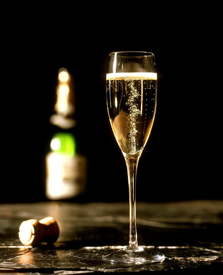 A Glass of Champagne with Champagne Cork