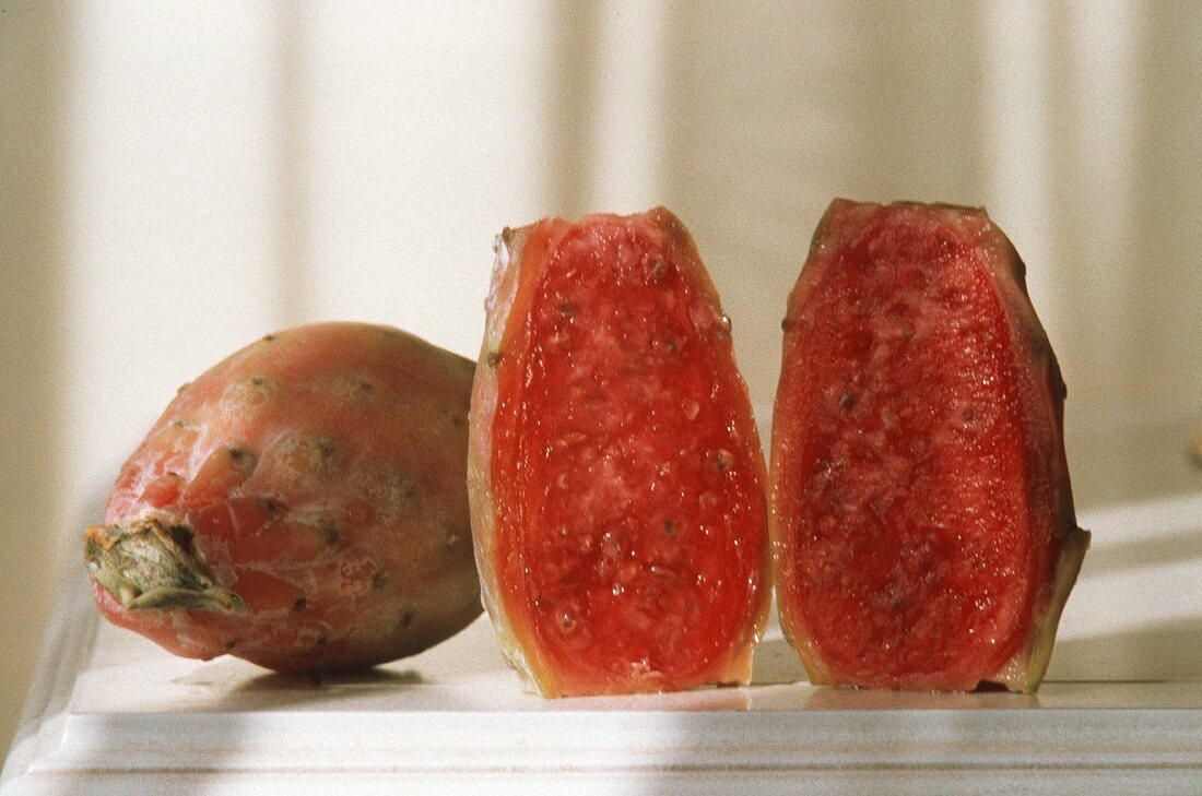 Two Cactus Pears; One Whole and One Cut in Half