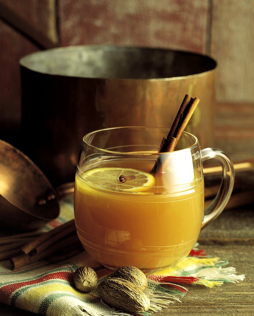 Hot Apple Cider with Cinnamon Sticks in a Glass Mug