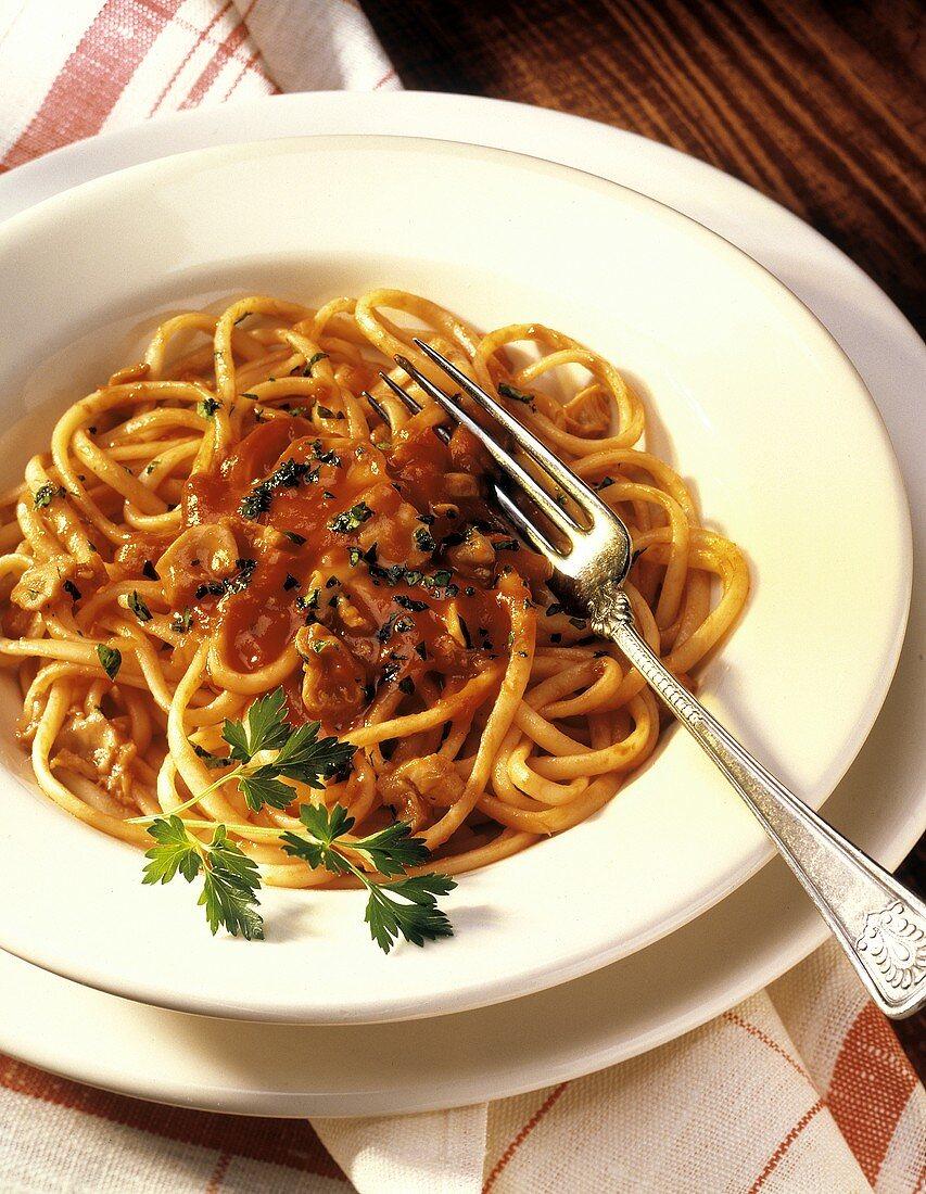 Linguine allo scoglio (Linguine with tomato and shellfish sauce)