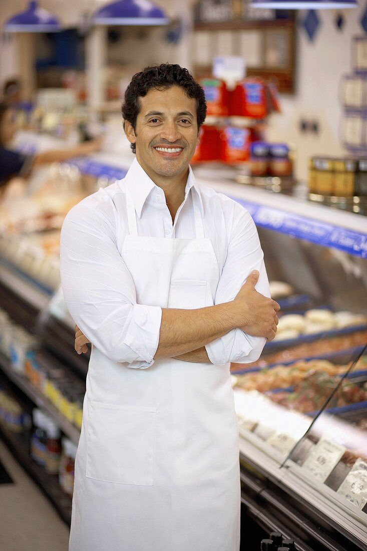 Butcher in the meat department of a supermarket