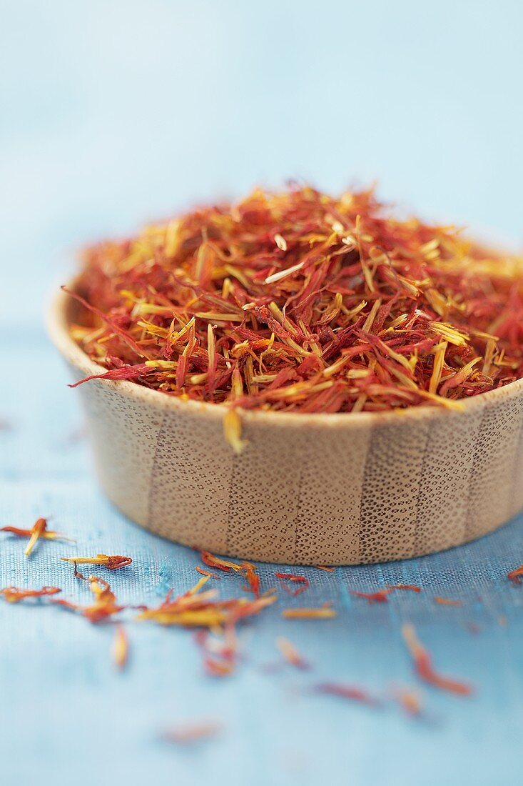 Dried safflower petals in bowl