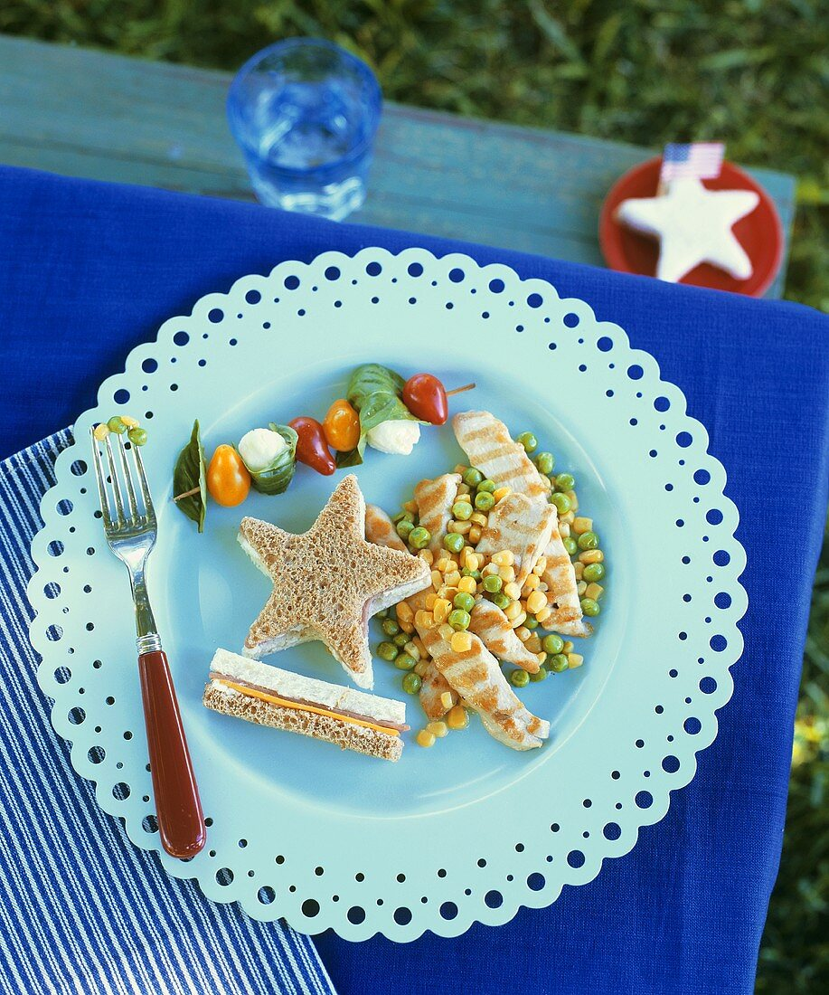 Child's meal: sandwich, chicken fillet, vegetables etc