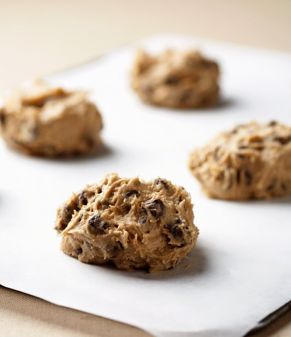 Chocolate Chip Cookie Dough Spooned onto a Cookie Sheet