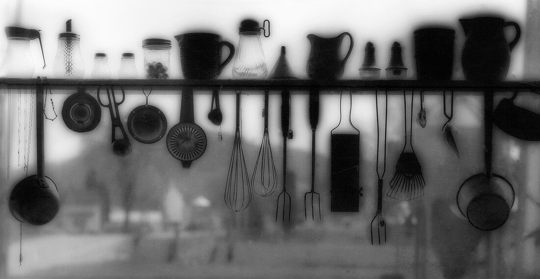 Kitchen Tools and Utensils on and Hanging from a Shelf with Farm in Background