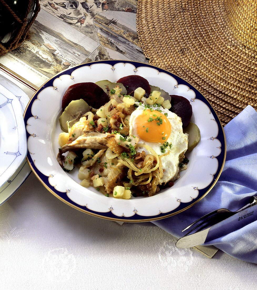 Smoked fish Labskaus with beetroot, gherkins, onions & egg