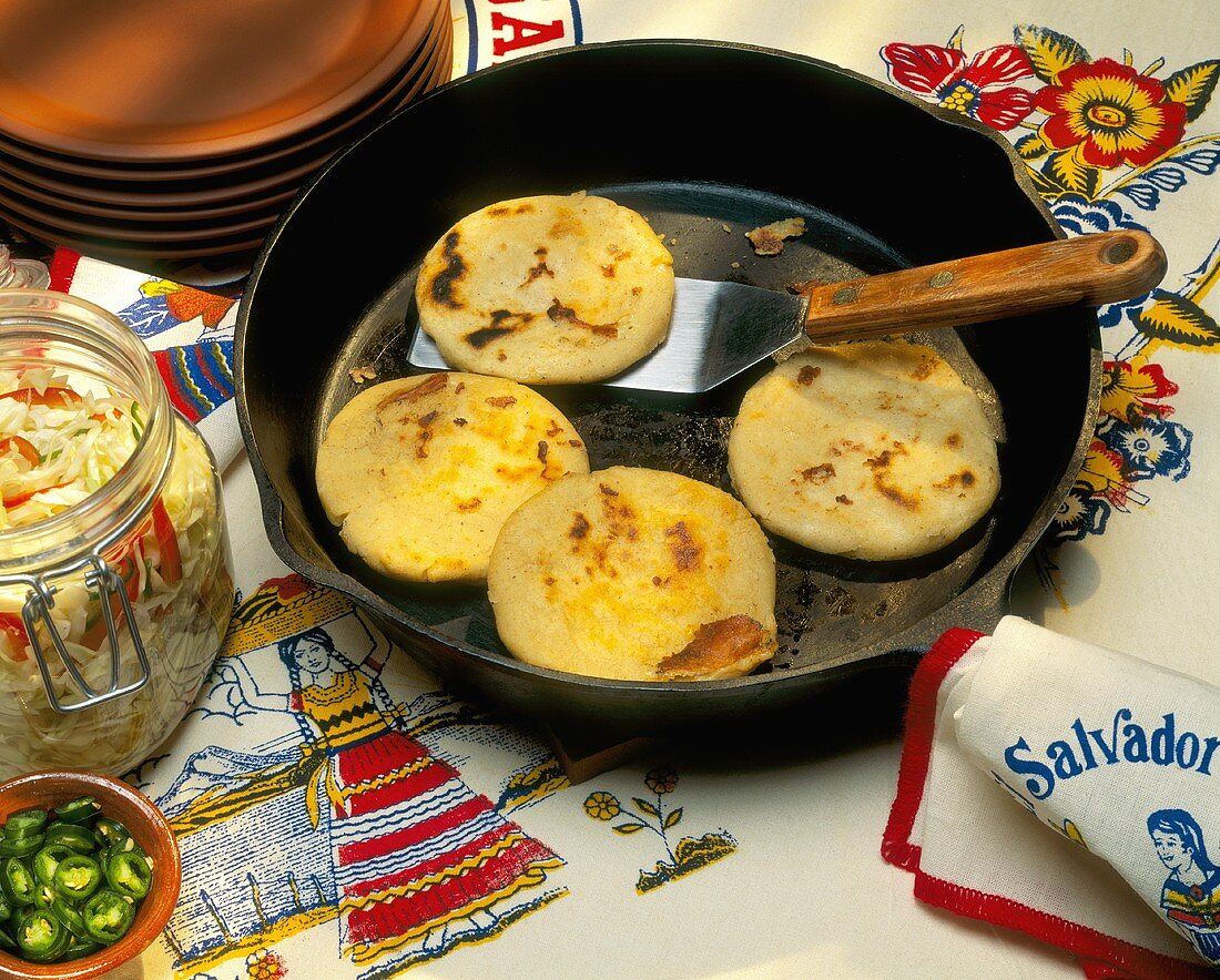 Pupusas in a Frying Pan with a Spatula