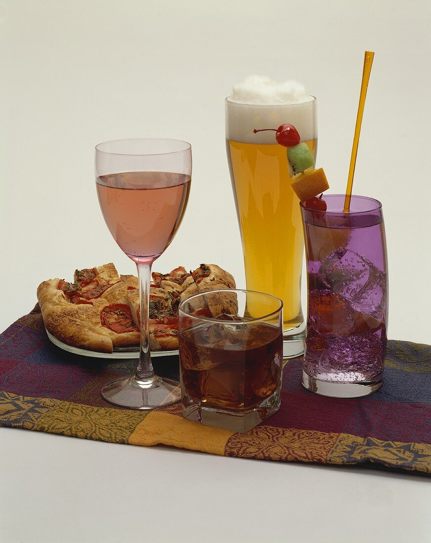 An Assortment of Alcoholic Beverages with Tomato Bread