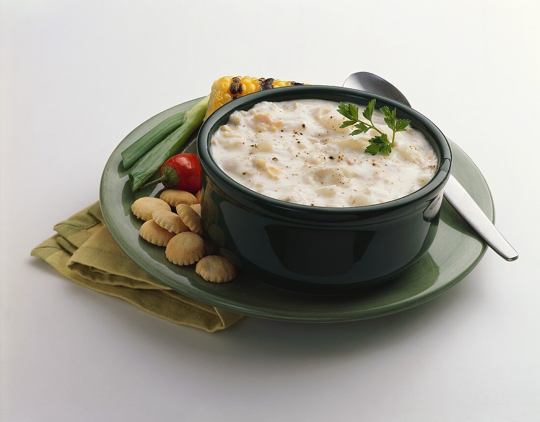 A Bowl of Clam Chowder with Oyster Crackers