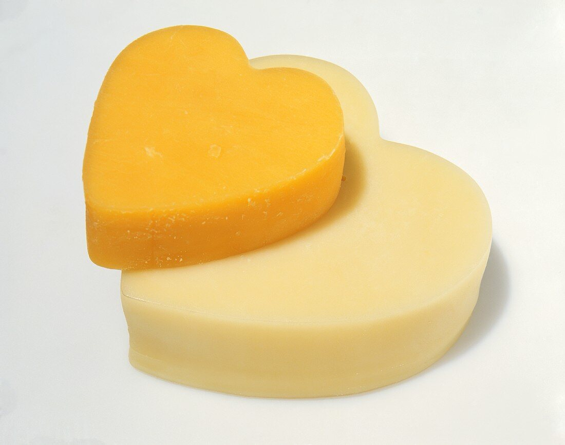 A Piece of Orange and a Piece of White Cheddar Cheese in the Shape of Hearts