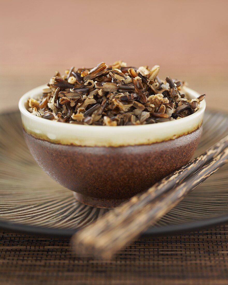 Bowl of Cooked Wild Rice with Chopsticks