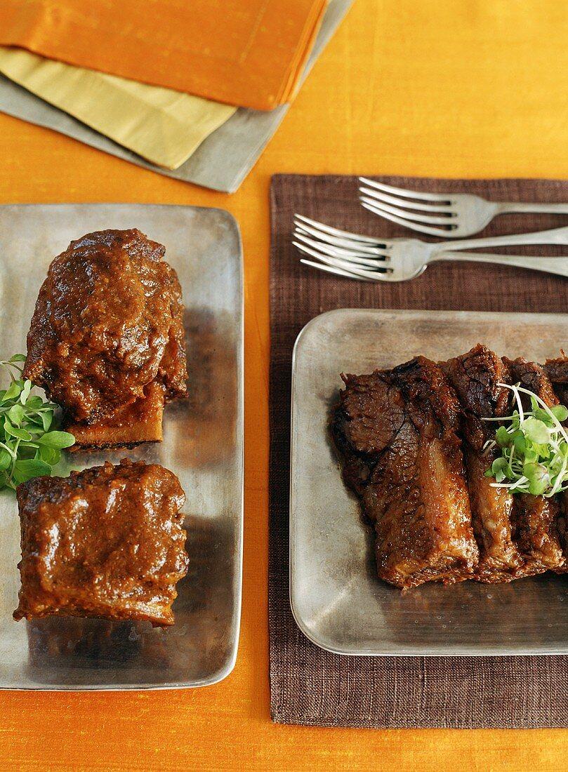 Braised Short Ribs and Barbecued Brisket on Metal Platters