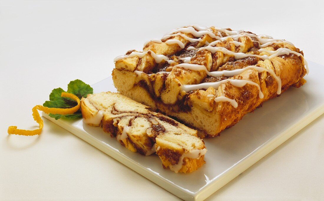 Partially Sliced Cinnamon Coffee Cake on a Platter