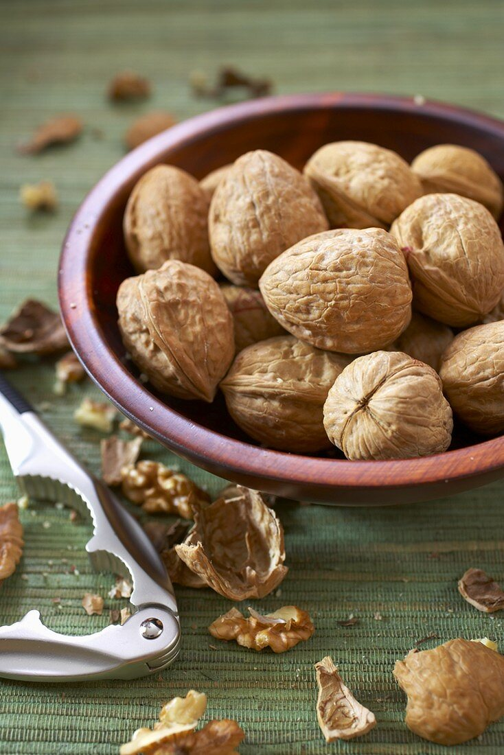 Bowl of Walnuts with Nut Cracker and Walnut Shells