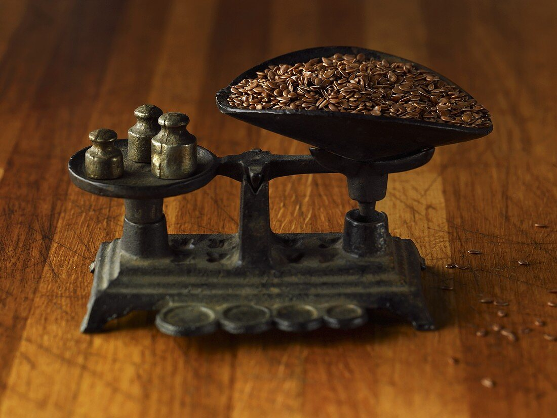 Flaxseeds on an old scale