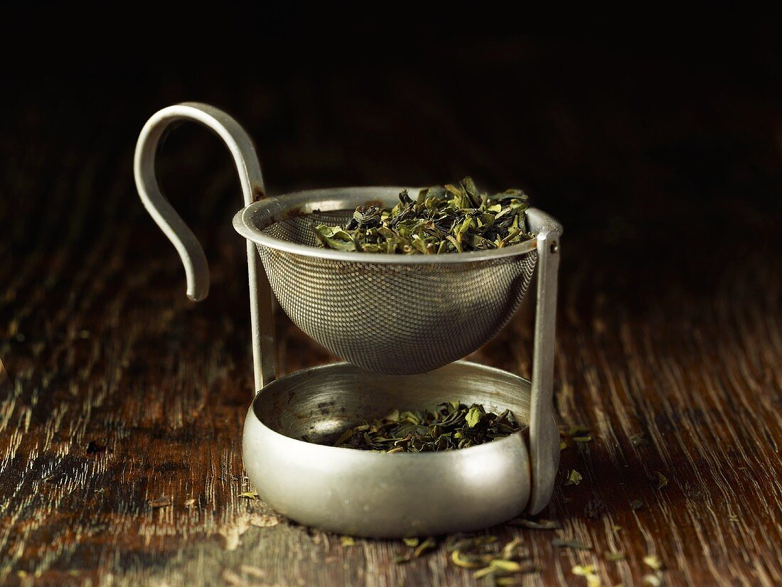 Green tea in a tea strainer