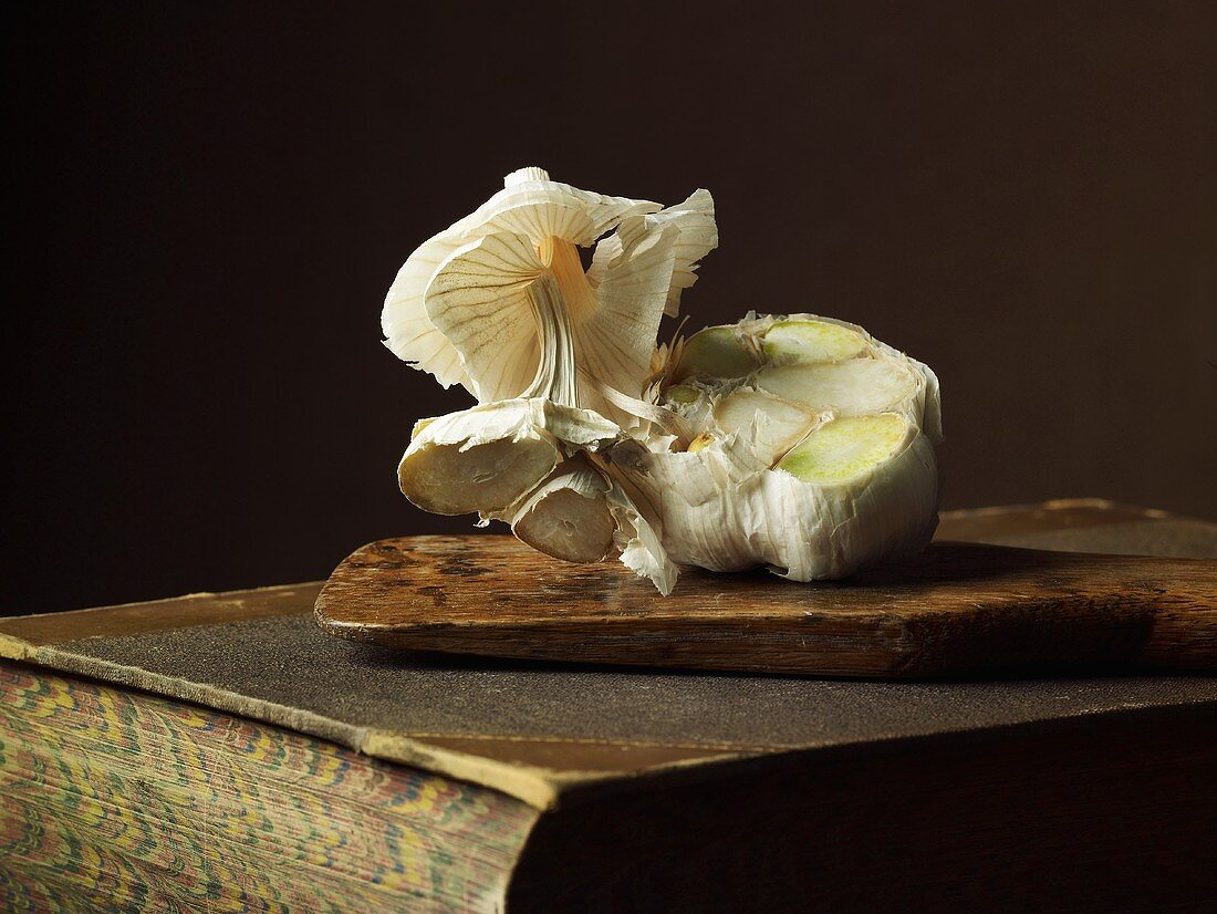 Fresh garlic on an old book