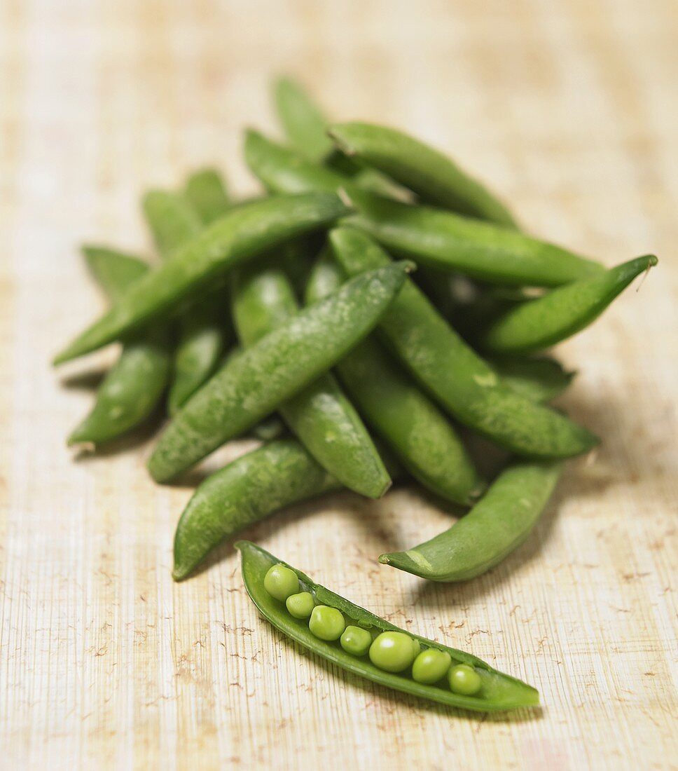 A Pile of Sugar Snap Peas; One Opened
