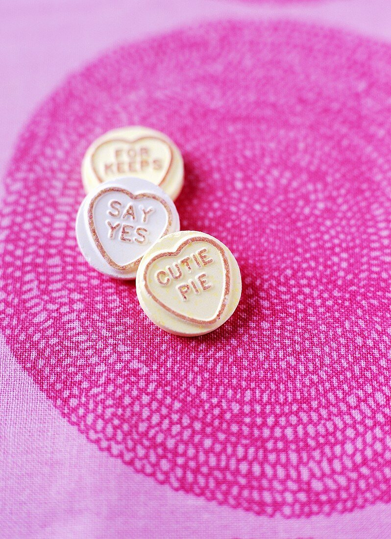 Sweets for Valentine's Day (Love Hearts) on pink cloth